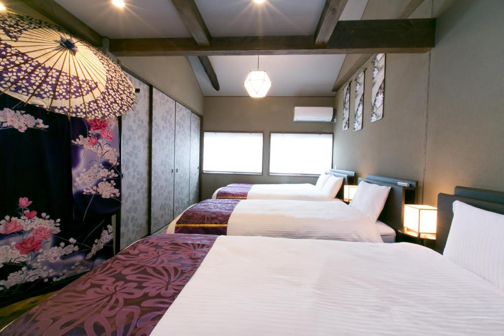 京町家 花の宿 華代にあるベッド