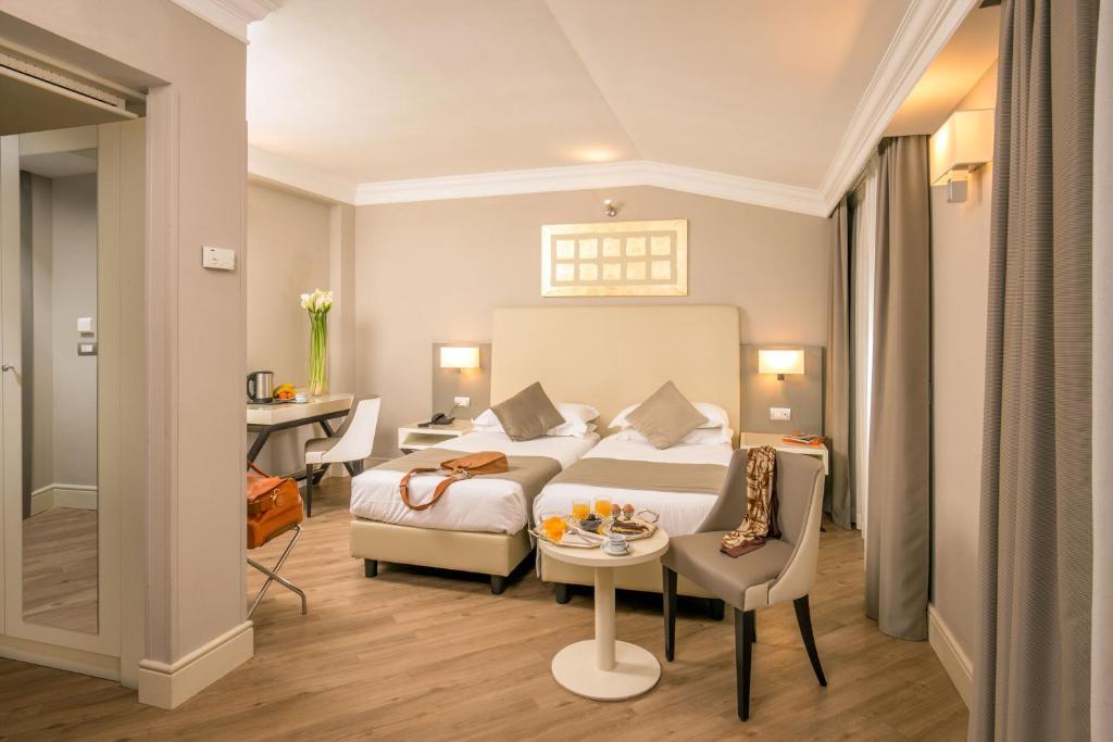 Cama ou camas em um quarto em Ludovisi Palace Hotel