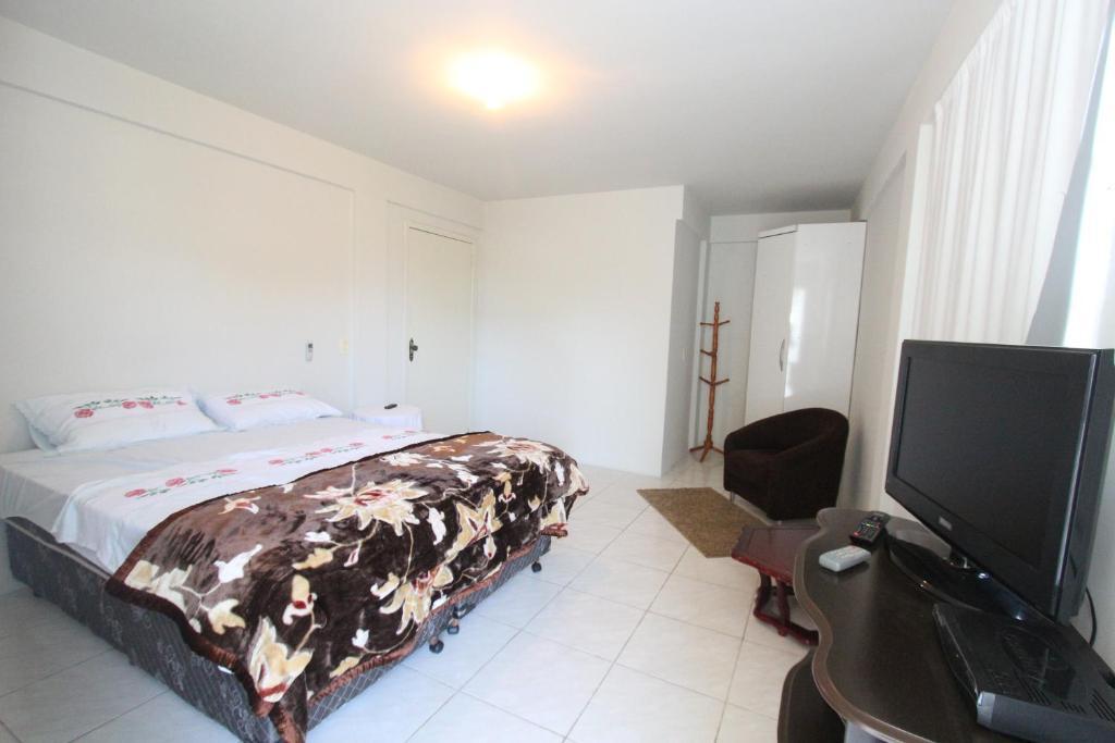 Cama ou camas em um quarto em Portal dos Canyons Hotel