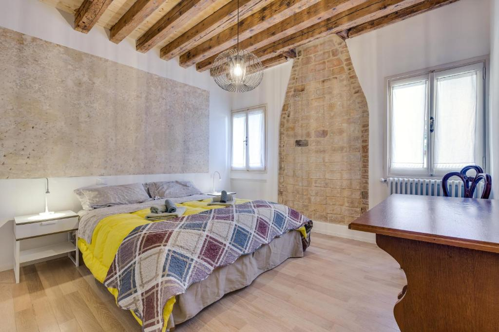 A bed or beds in a room at Arsenale Venezia Biennale