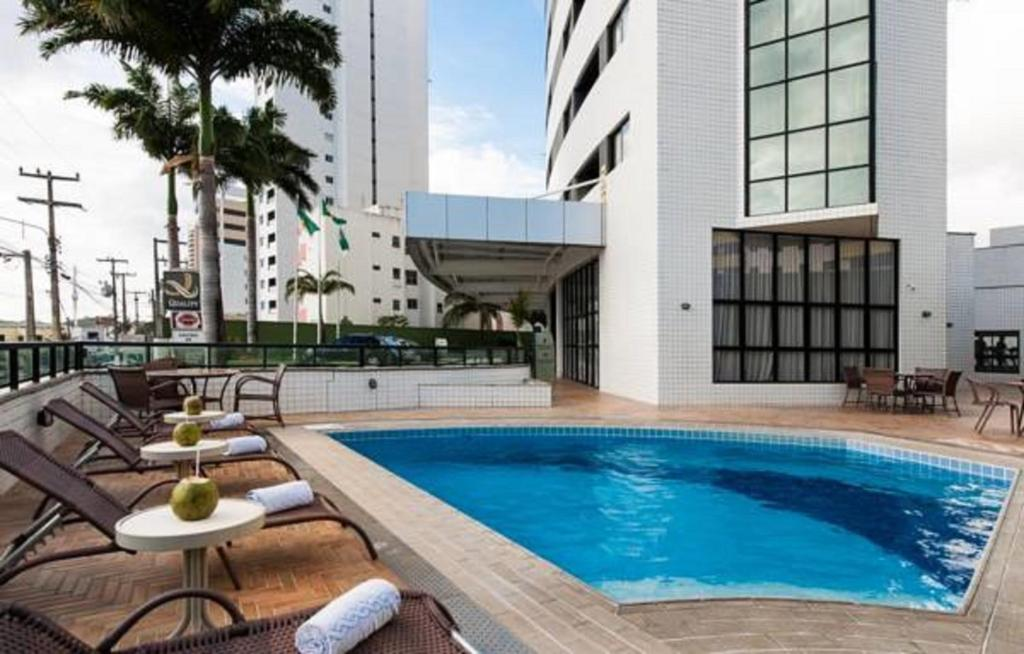 The swimming pool at or near Quality Suites Natal Ponta Negra