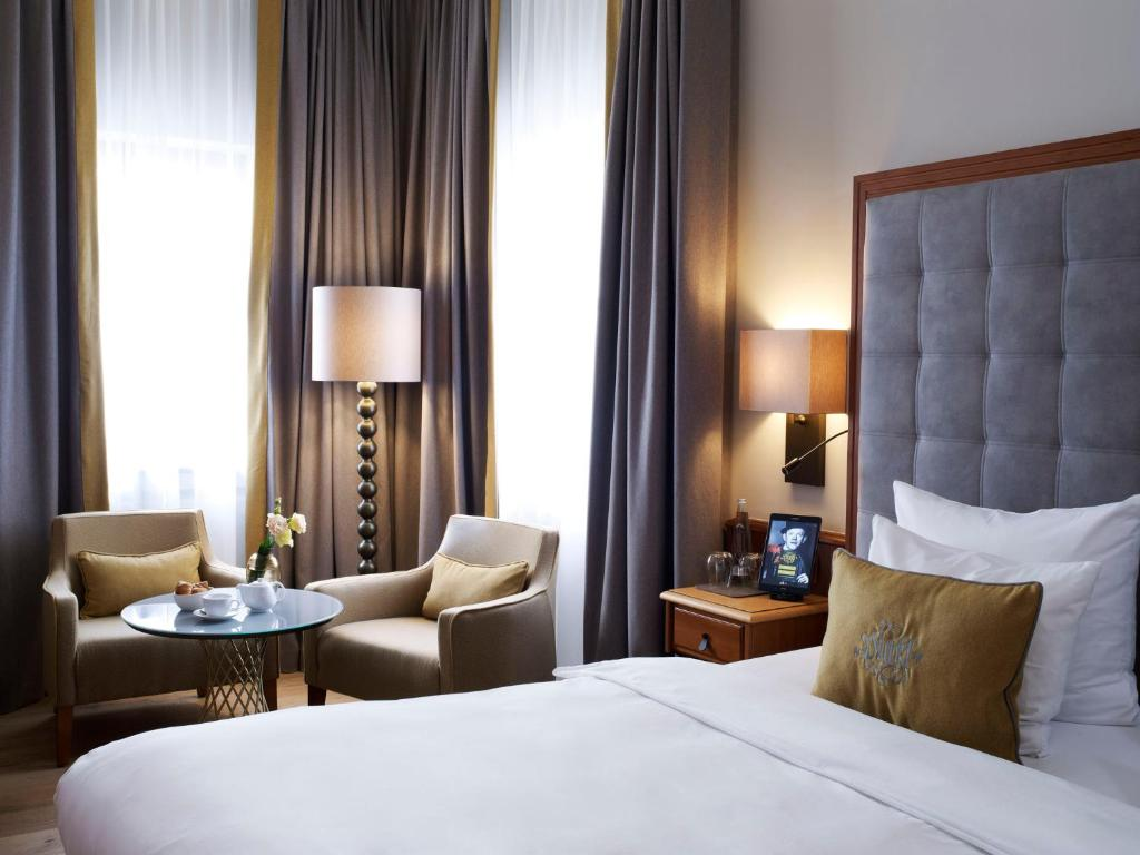 A bed or beds in a room at Platzl Hotel - Superior
