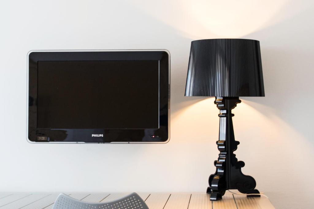 A television and/or entertainment center at B's Strandappartementen
