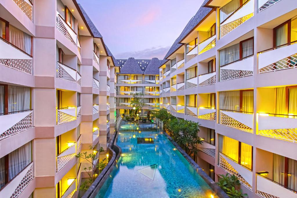 A view of the pool at Episode Kuta Bali or nearby