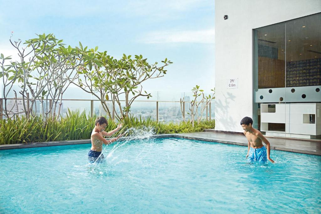 The swimming pool at or near DoubleTree by Hilton Melaka