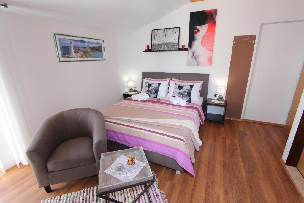 Letto o letti in una camera di Rooms and Apartments Matosevic