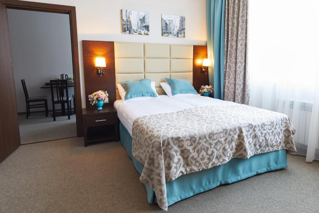 Кровать или кровати в номере Гостиница Тулица