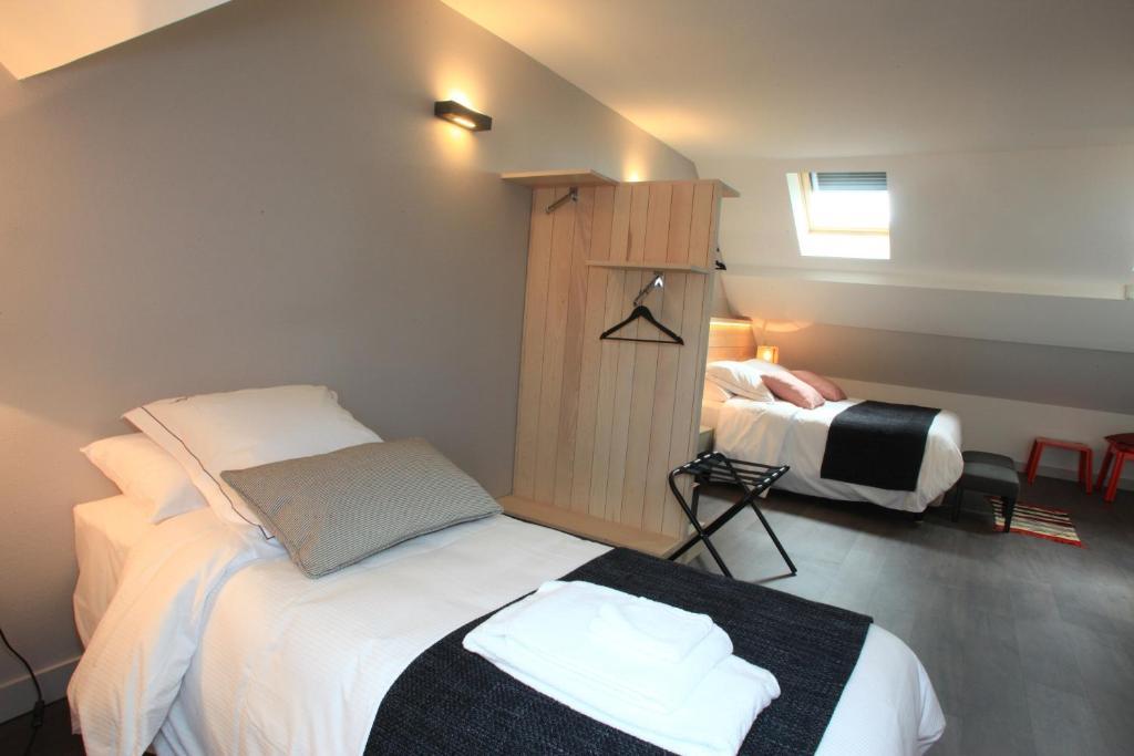 Un ou plusieurs lits dans un hébergement de l'établissement Hotel-Restaurant Le Relais d'Aligre