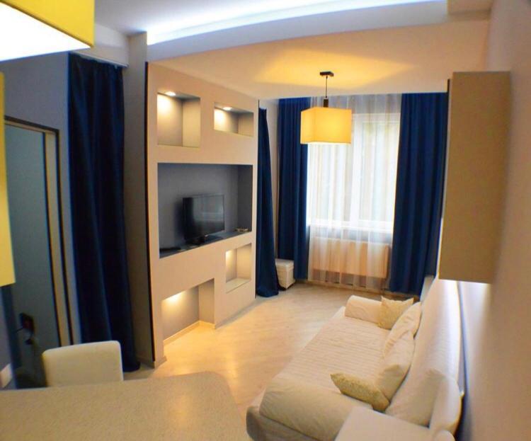 A television and/or entertainment center at Apartments U morya