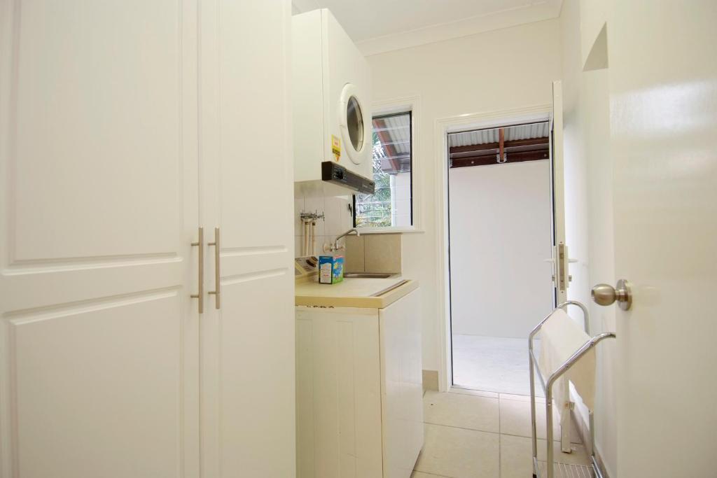 A kitchen or kitchenette at 67 Casuarina Beachhouse