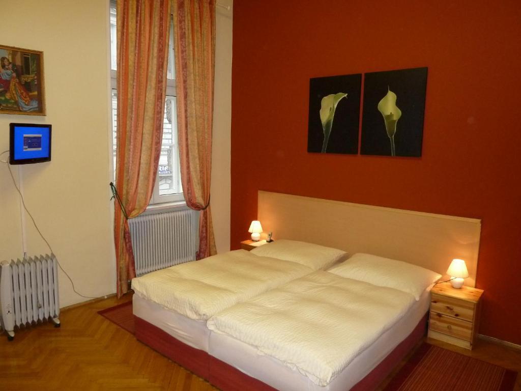מיטה או מיטות בחדר ב-Pension Gross