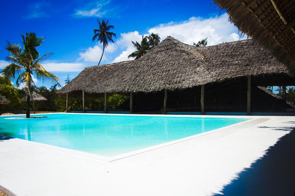 The swimming pool at or near Blue Moon Resort