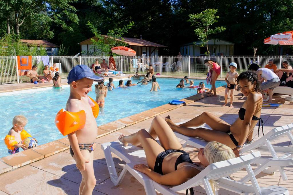 The swimming pool at or near Camping Village L'Apamée