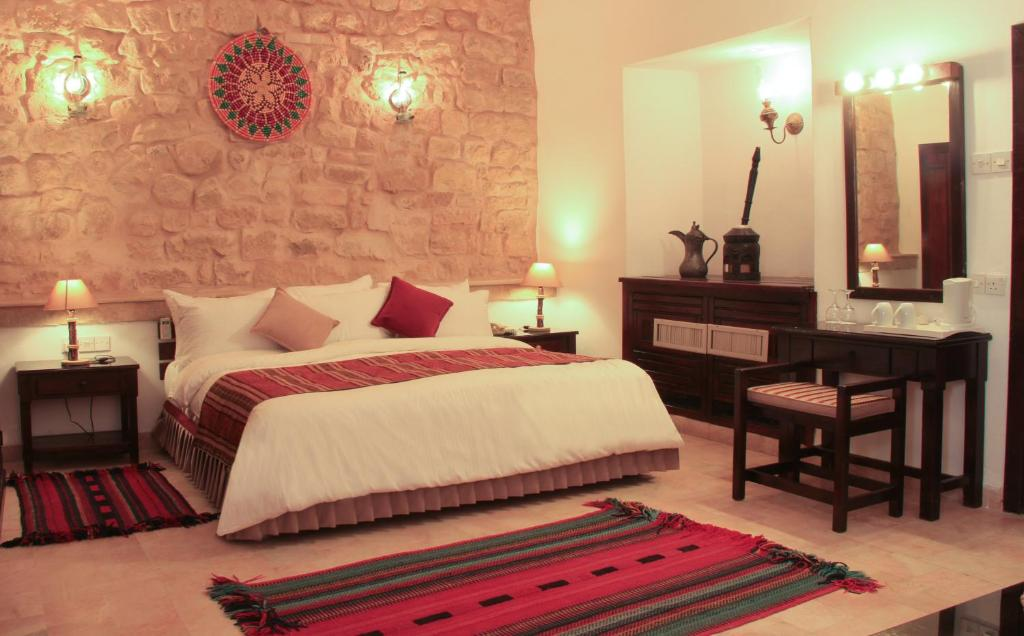 A bed or beds in a room at Hayat Zaman Hotel And Resort Petra