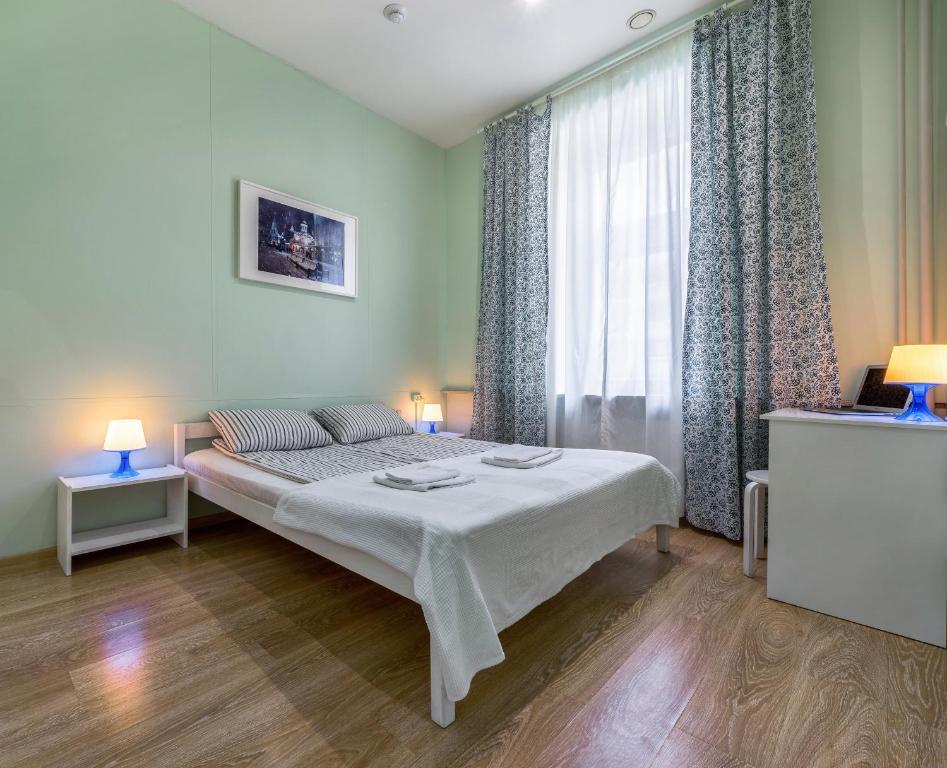 Кровать или кровати в номере Хостел Маяковский