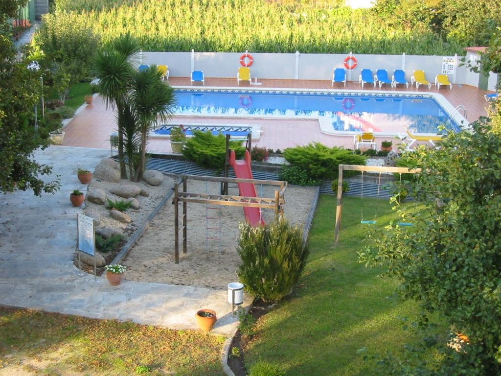 A view of the pool at Hotel Cabo Festiñanza or nearby