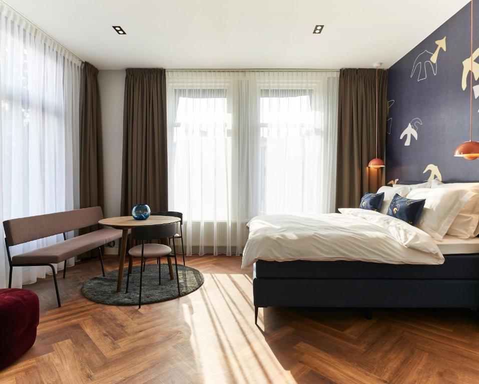 Ein Bett oder Betten in einem Zimmer der Unterkunft Hotel Pistache Den Haag