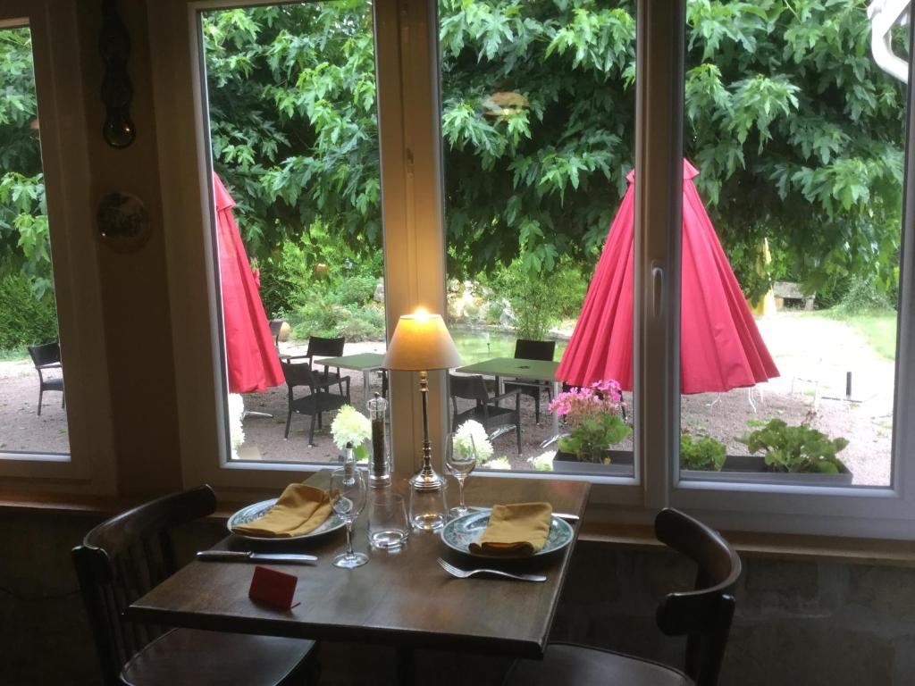A restaurant or other place to eat at Hostellerie du Vieux Moulin
