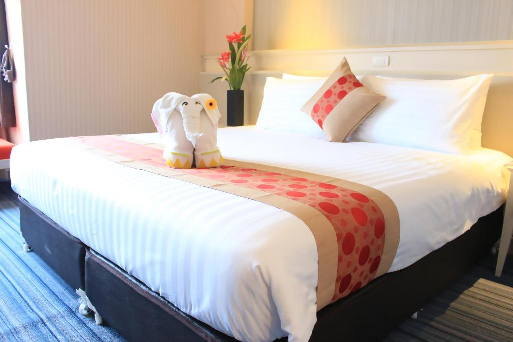 A bed or beds in a room at V Wish Hotel