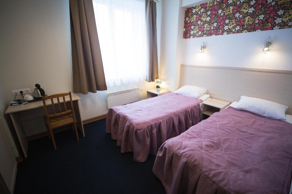 Кровать или кровати в номере Hotel Argo
