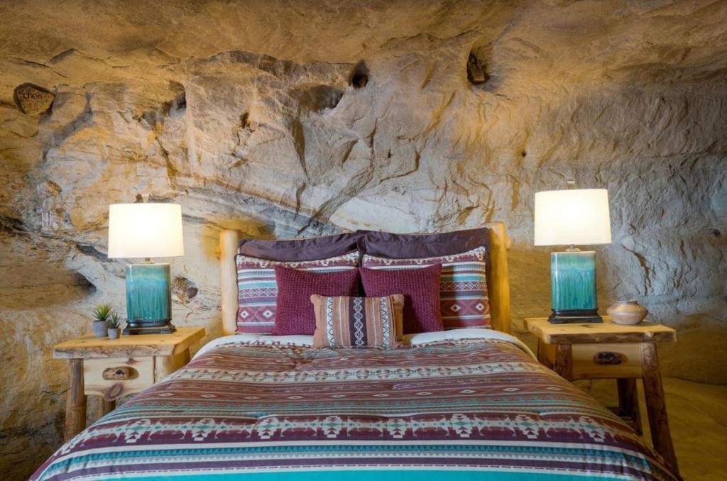 Voodi või voodid majutusasutuse Kokopelli's Cave toas