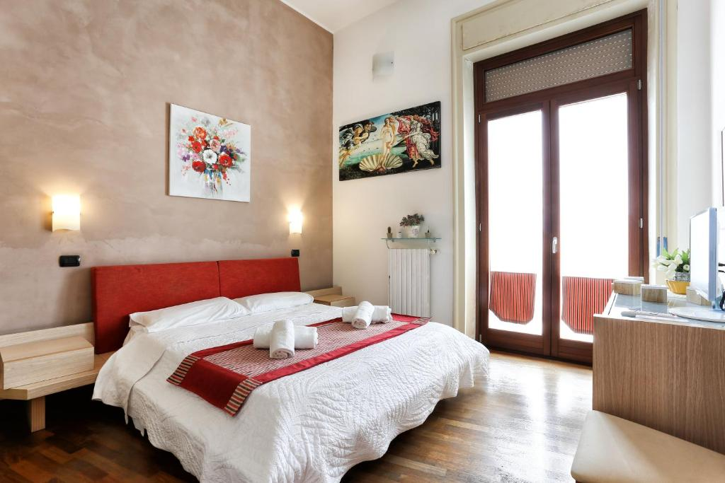 A bed or beds in a room at B&B Ortigia Bedda