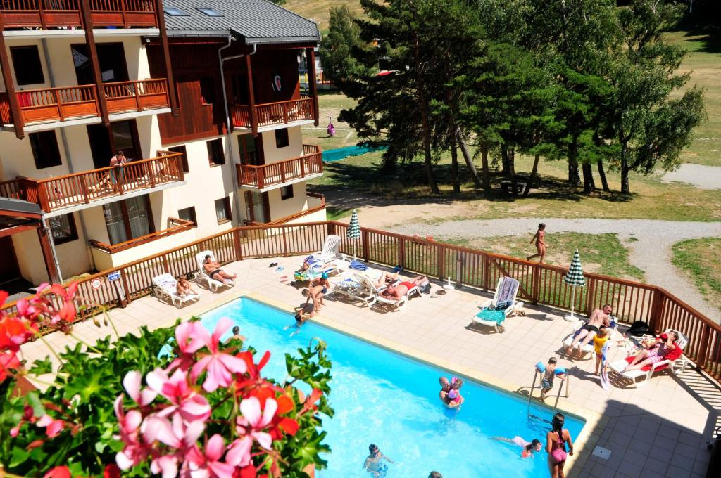 A view of the pool at Résidence Goélia Les Balcons d'Anaïs or nearby