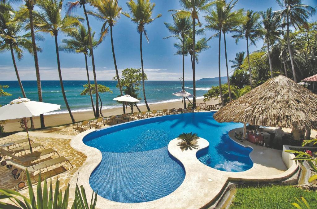 Vue sur la piscine de l'établissement Tango Mar Beachfront Boutique Hotel & Villas ou sur une piscine à proximité
