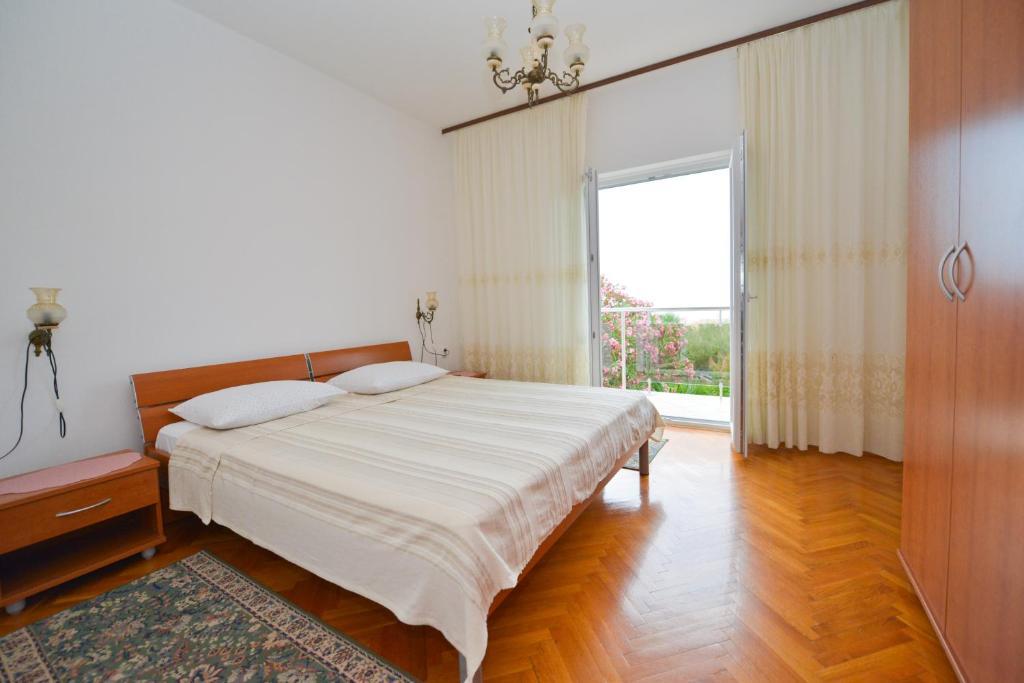 Posteľ alebo postele v izbe v ubytovaní Nikodem Apartment