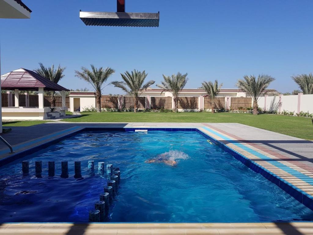 The swimming pool at or near Asahalah Farm Villas