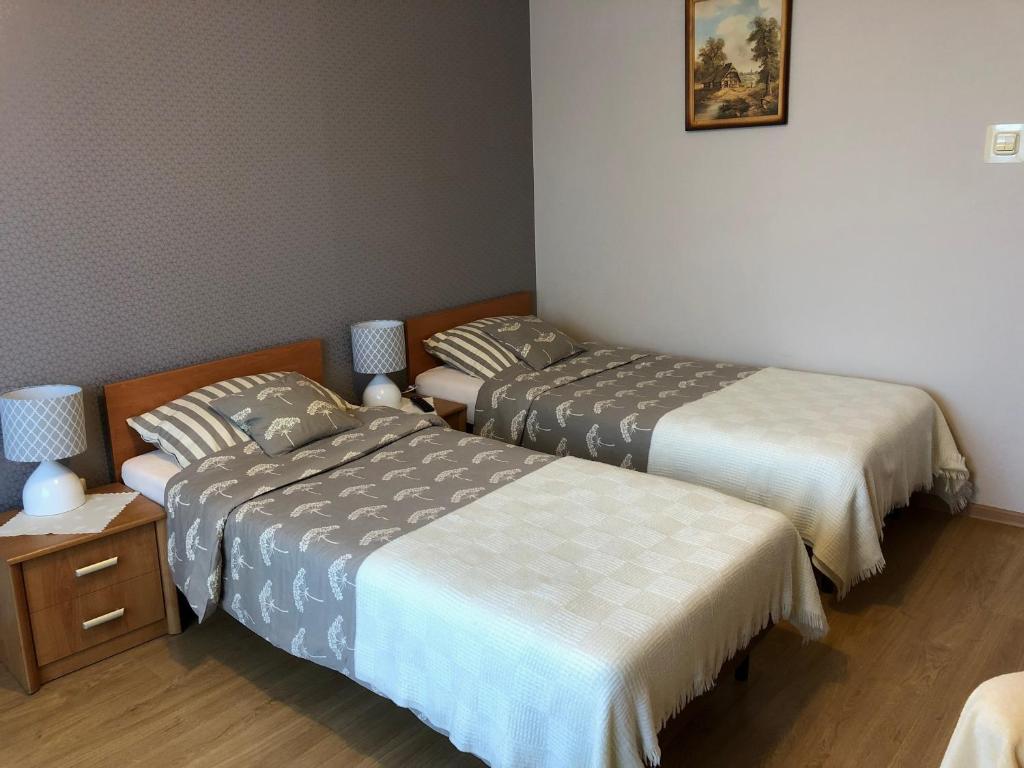 Łóżko lub łóżka w pokoju w obiekcie Gospodarstwo Agroturystyczne JAGODA