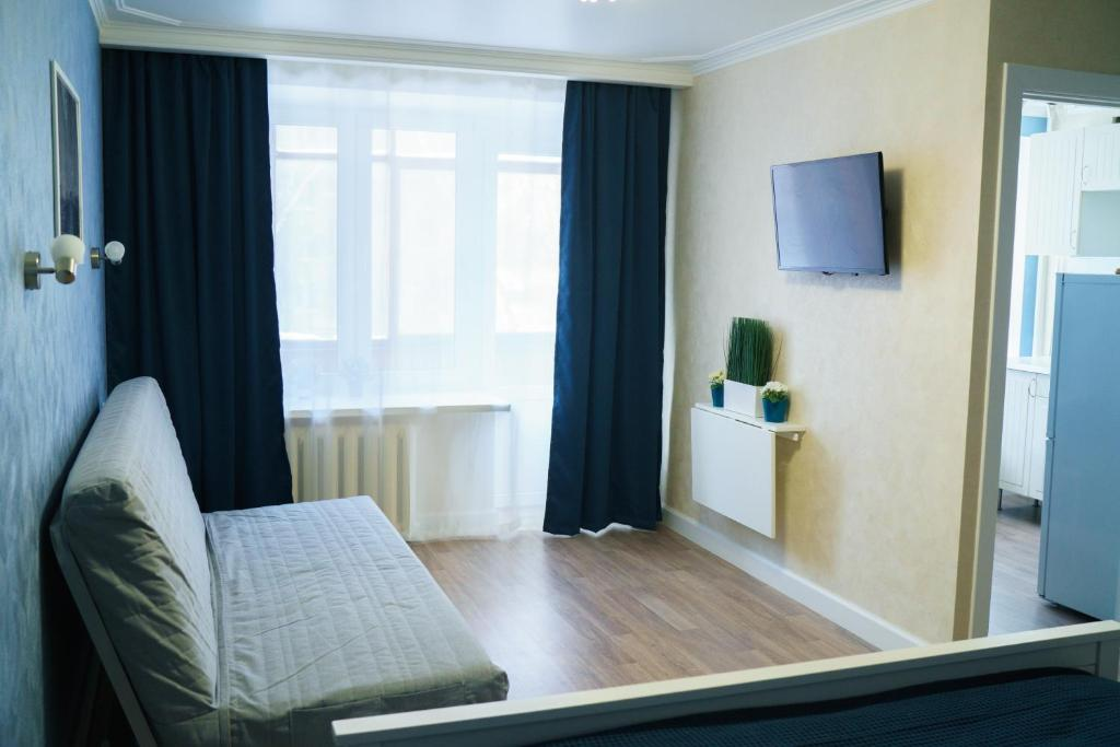 A bed or beds in a room at ApartLux