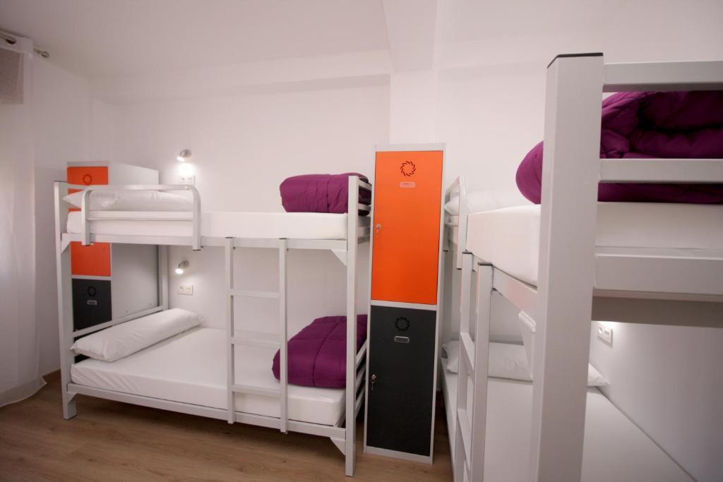 A bunk bed or bunk beds in a room at Albergue Lalin Centro