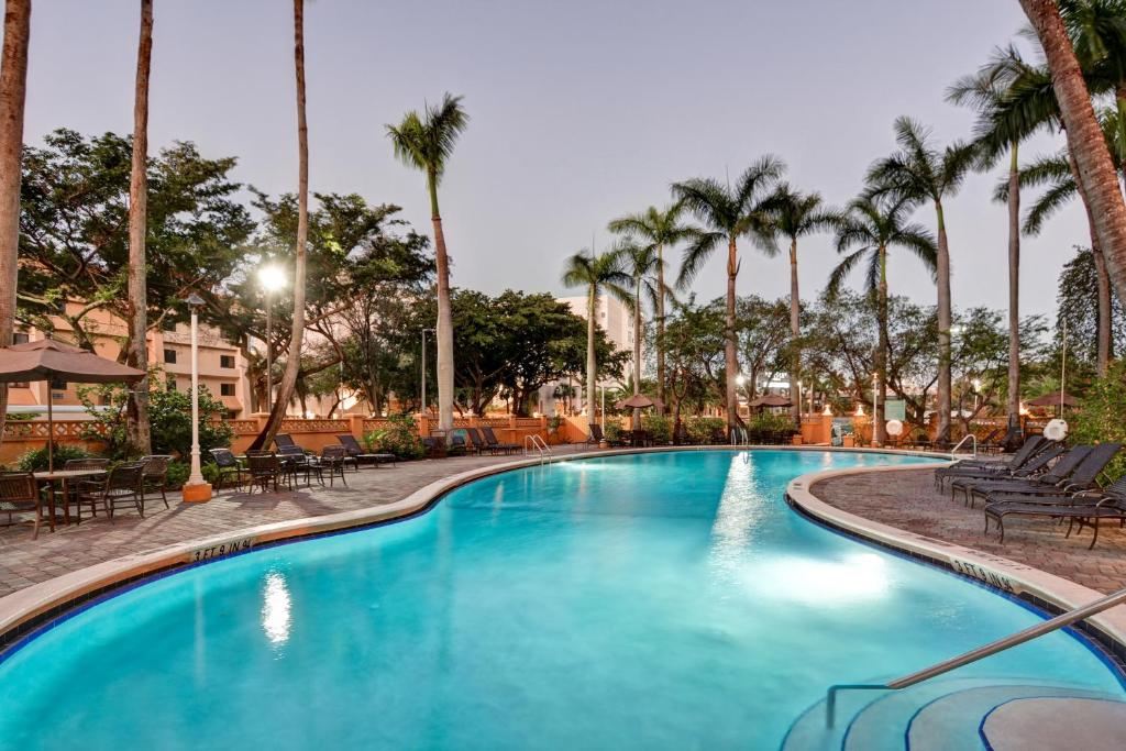 The swimming pool at or near Embassy Suites by Hilton Miami International Airport