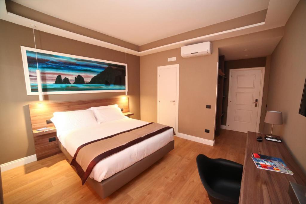 Letto o letti in una camera di 7th Floor Suite