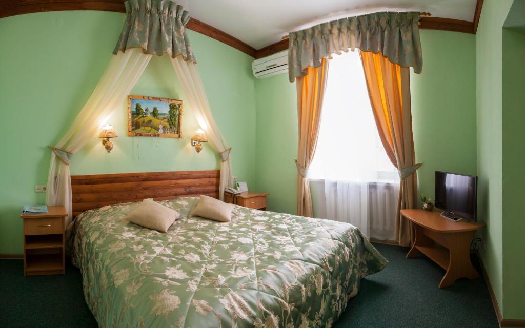 Кровать или кровати в номере Гостиница Снегурочка