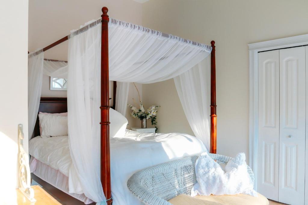 A bed or beds in a room at Star of the Sea B&B