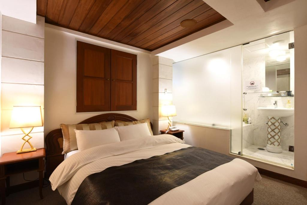 A bed or beds in a room at Goethe Hotel Omori