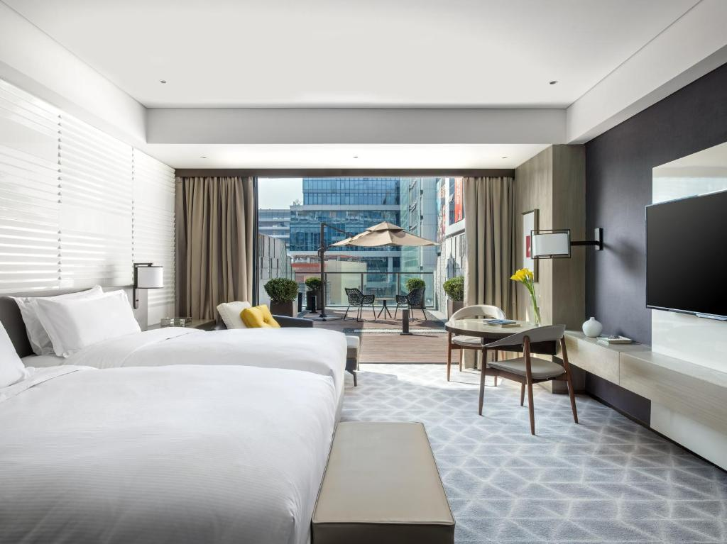 A room with a balcony at the Cordis Shanghai Hongqiao.
