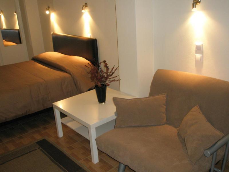 Ένα ή περισσότερα κρεβάτια σε δωμάτιο στο Ξενοδοχείο Νίκη