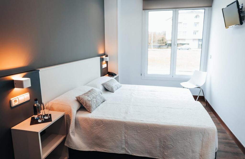 Cama o camas de una habitación en Pensión Rúa Peregrino