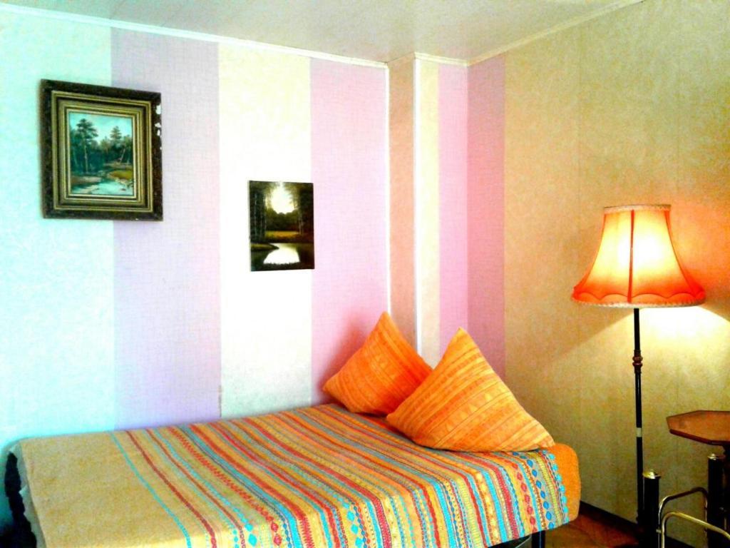 Кровать или кровати в номере Апартаменты улица Новинки