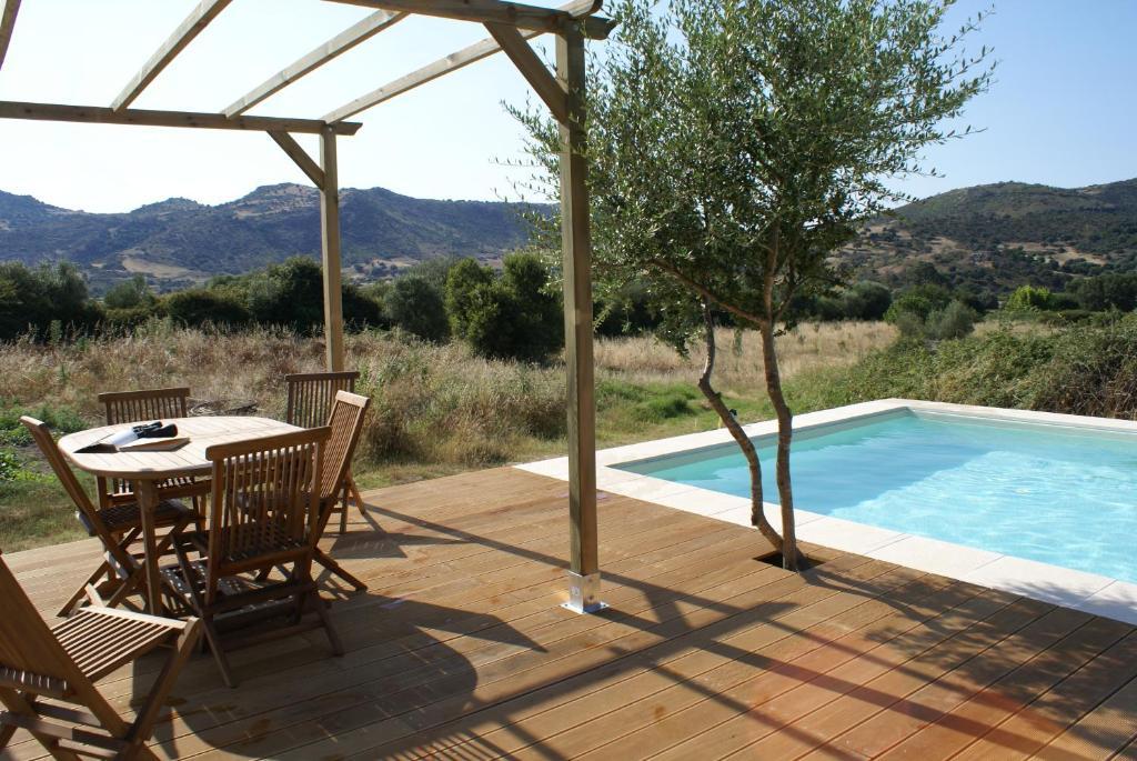 The swimming pool at or near Agriturismo L'Aglientu B&B