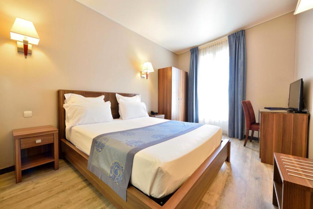 Cama o camas de una habitación en Hotel Capitole