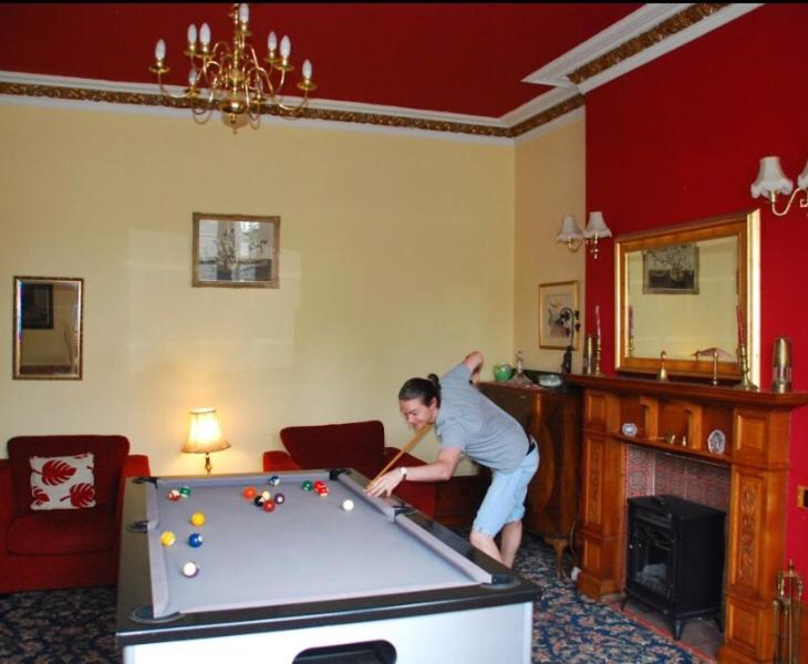 A pool table at Denmore Guest House