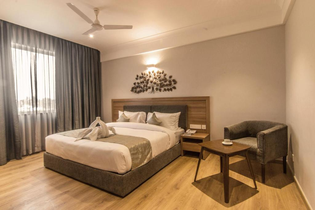 A bed or beds in a room at Native By Chancery Hotels