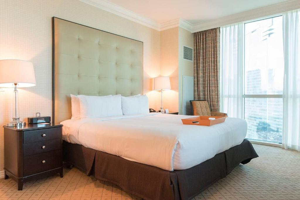 A bed or beds in a room at True 1BR Balcony Suite with Strip View at MGM Signature