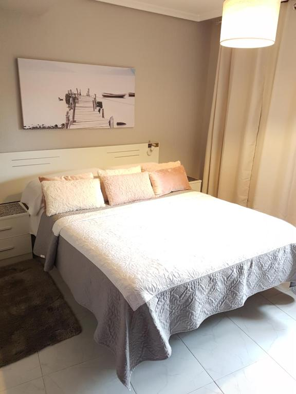 Cama o camas de una habitación en Hostal la Picota