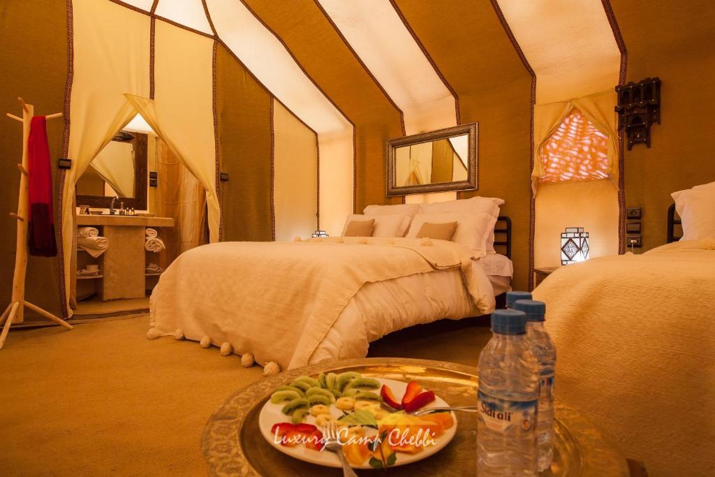 Un ou plusieurs lits dans un hébergement de l'établissement Luxury Camp Chebbi
