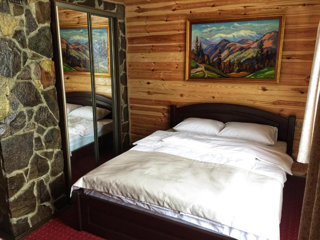 Ліжко або ліжка в номері Синій Вир
